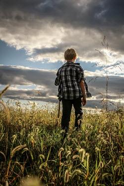 Stephen Carroll BOY WALKING IN FIELD Children
