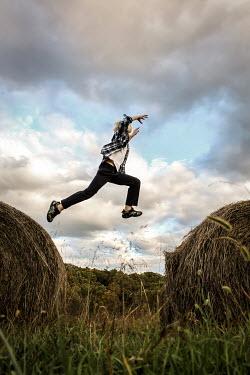 Stephen Carroll BOY JUMPING ON HAY BALES Children