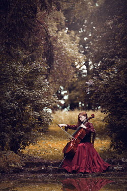Magdalena Russocka WOMAN IN RED DRESS PLAYING CELLO Women