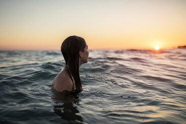 Alessio Albi YOUNG WOMAN SWIMMING IN SEA Women