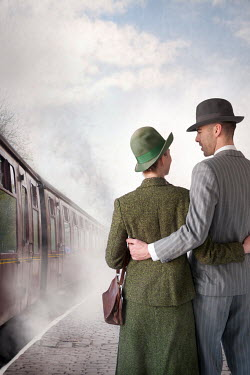 Lee Avison 1940s COUPLE ON PLATFORM BY STEAM TRAIN Couples