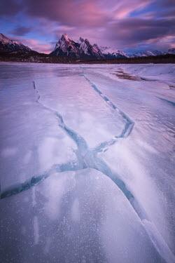 Viktoria Haack FROZEN LAKE BY SNOW CAPPED MOUNTAINS Rocks/Mountains