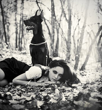 Margarita Kareva WOMAN LYING NEAR DOG IN COUNTRYSIDE Women