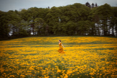 Amelie Satzger WOMAN RUNNING IN FLOWERY FIELD Women