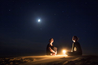 Amelie Satzger TWO WOMEN STAR GAZING IN DESERT Women