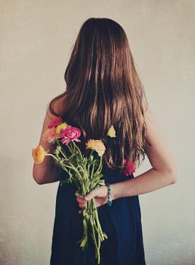 Elle Moss TEENAGE GIRL WITH FLOWERS BEHIND BACK Women