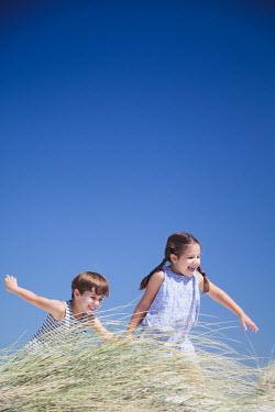 Miguel Sobreira TWO CHILDREN ON SAND DUNE Children