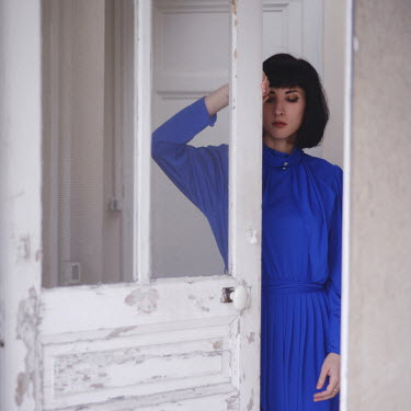 Anna Rakhvalova YOUNG WOMAN IN BLUE DRESS OPENING DOOR Women