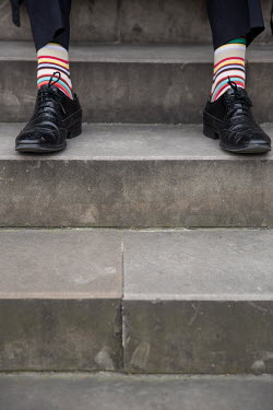 Colin Hutton MAN WITH STRIPEY SOCKS ON STEPS See All People