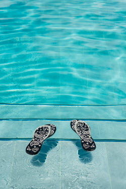 Colin Hutton FLIP FLOPS FLOATING IN SWIMMING POOL Miscellaneous Objects