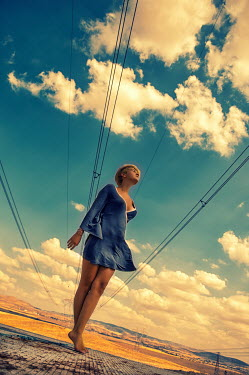 Metin Demiralay WOMAN UNDER RURAL TELEPHONE WIRES Women