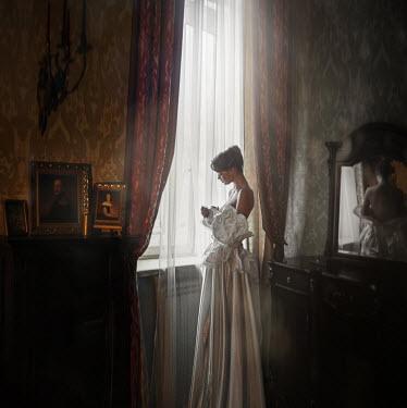 Tatiana Mertsalova VINTAGE WOMAN UNDRESSING INDOORS Women