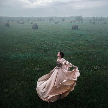 Tatiana Mertsalova WOMAN WEARING GOWN IN COUNTRYSIDE Women