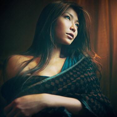 Vanessa Ho ASIAN WOMAN WEARING SHAWL INDOORS Women