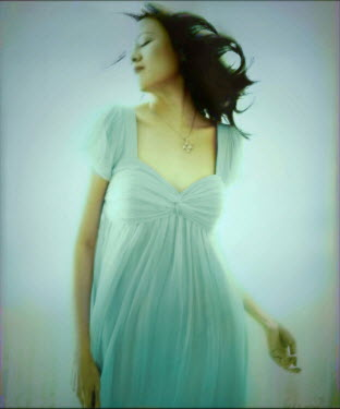 Vanessa Ho YOUNG WOMAN WEARING A FLOWING BLUE DRESS Women