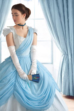 Lee Avison victorian woman in a blue ballgown at the window Women