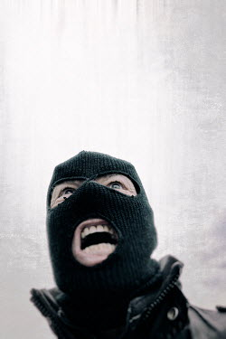 Tim Robinson CLOSE UP OF ANGRY MAN IN BALACLAVA Men