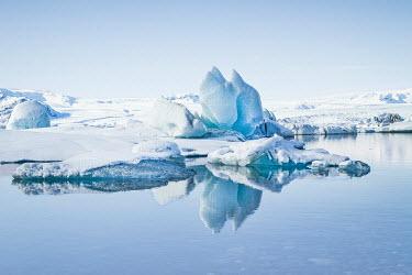 Evelina Kremsdorf SNOWY ICEBERG REFLECTED IN SEA Snow/ Ice