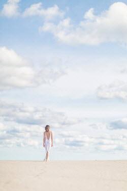 Evelina Kremsdorf WOMAN WALKING ON SANDY BEACH Women