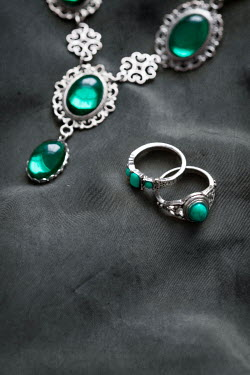 Lee Avison CLOSE UP OF GREEN GEM JEWELLERY Miscellaneous Objects