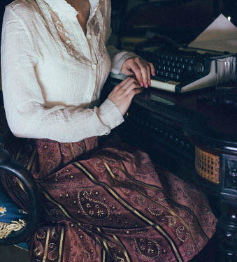 Antonie De La Roquelle VINTAGE WOMAN SITTING BESIDE TYPEWRITER Women