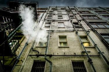 Graham Hunt URBAN BRICK BUILDING UNDER GREY SKY Miscellaneous Buildings