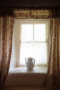 Christine Amat JUG ON RUSTIC WINDOW SILL INDOORS Interiors/Rooms