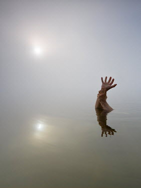 Leszek Paradowski CLOSE UP OF MANS HANDS IN STILL LAKE Body Detail