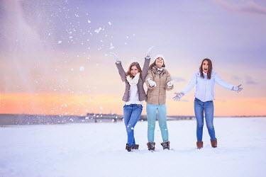 Evelina Kremsdorf THREE HAPPY WOMEN PLAYING IN SNOW Groups/Crowds