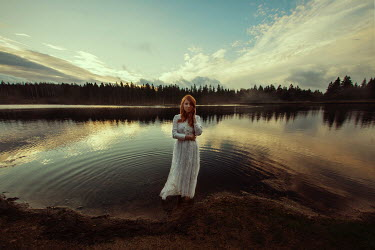 Sandra Scherer WOMAN STANDING IN LAKE AT SUNRISE Women