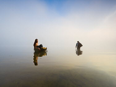 Leszek Paradowski MUSICIAN COUPLE IN STILL LAKE Couples