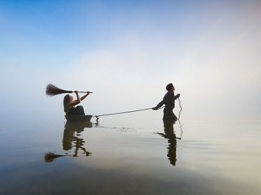 Leszek Paradowski COUPLE WITH BROOM IN STILL LAKE Couples