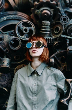 Inna Mosina WOMAN IN GOGGLES BESIDE MACHINE PARTS Women
