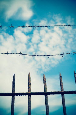 Mohamad Itani WIRE AND FENCE UNDER BLUE SKY Gates