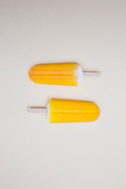Jovana Rikalo TWO YELLOW ICE LOLLIES CLOSE UP Miscellaneous Objects