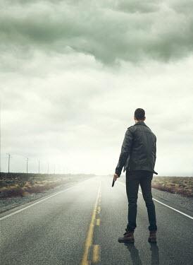 Mark Owen MAN WITH GUN ON EMPTY COUNTRY ROAD Men
