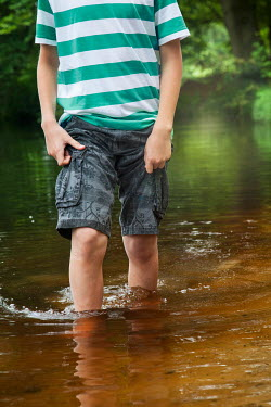 Yolande de Kort MODERN BOY WADING THROUGH LAKE Children