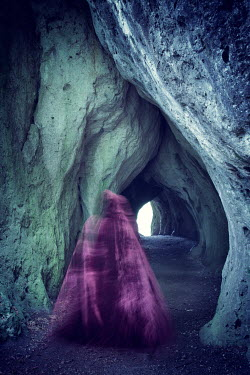 Carmen Spitznagel WOMAN IN CLOAK INSIDE ROCKY CAVE Women