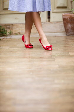 Nina Masic WOMANS FEET IN RETRO RED SHOES Women