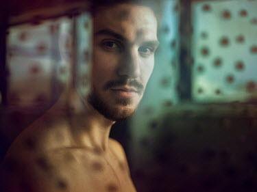 Michal Zahornacky WINDOW LIGHTS REFLECTED ON MAN Men