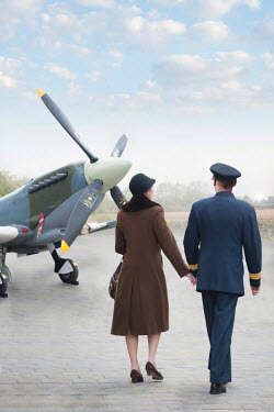 Lee Avison 1940S COUPLE BESIDE VINTAGE AEROPLANE Couples