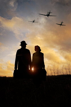 Lee Avison SILHOUETTE OF 1940S COUPLE AND AEROPLANES Couples