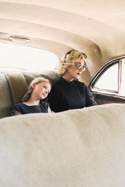 Elisabeth Ansley RETRO WOMAN AND CHILD INSIDE CAR Groups/Crowds