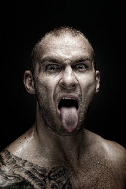 Sylwia Makris ANGRY TATTOOED MAN POKING TONGUE OUT Men