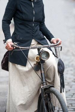 Lee Avison HISTORICAL WOMAN ON BICYCLE Women