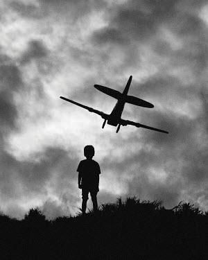 Hengki Lee SILHOUETTE OF BOY LOOKING AT AEROPLANE Children