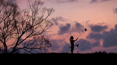 Hengki Lee SILHOUETTE OF GIRL RELEASING BIRD AT SUNSET Children