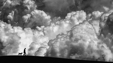 Hengki Lee SILHOUETTE OF MAN AND DOG IN STORM Men