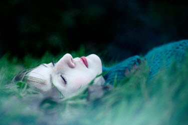 Magdalena Russocka YOUNG WOMAN LYING IN GRASS Women