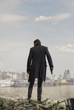 CollaborationJS MAN WITH GUN NEAR LONDON RIVER Men
